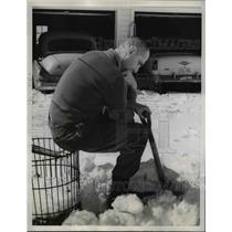 1959 Press Photo Monhoe Wisc Raymond Ernest shovels snow at his home - nee03520