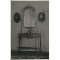 1925 Press Photo Console, Mirror, Candlesticks, Oval Paintings, rug & Book Ends