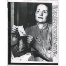 1957 Press Photo of Mrs. Marietta Gheza holding a football pool ticket worth