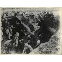 1945 Press Photo Workers Clear Debris After Street Caved From Heavy Flooding
