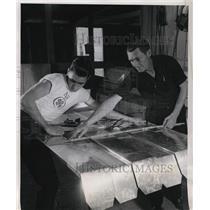 1952 Press Photo Farmer Chuck & dad EF Morrow make metal awnings in a shop