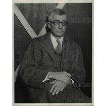 1933 Press Photo Leo Gallagner looks serious while sitting down - nee16983