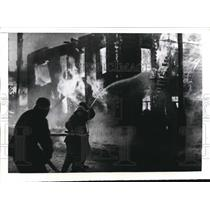 1942 Press Photo Finnish firemen at Petroskoi ste ablaze by Russians - nee18119