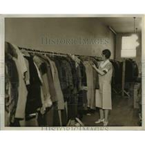 1932 Press Photo Mrs. G.F. Knobloch of Detroit Avenue with the used clothing