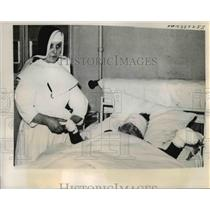 1940 Press Photo French Hospital Nun Comforts Refugee Victim, World War II