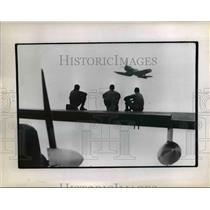 1970 Press Photo Airmen Sitting on Wing of Plane Watch Airshow - nee38309