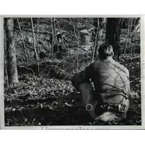 1958 Press Photo Taking cover behind a tree, A Revenooer  - nee26021