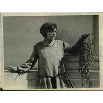 1926 Press PhotoMiss Vivian Chastek displays a sample of the puncture vine