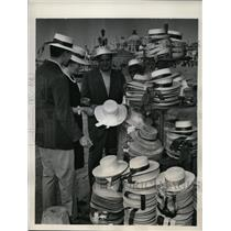 1961 Photo movie producer Jerry Wald and son hat shop Venice Italy