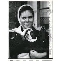 1959 Press Photo Vicki Krengel keeps dog, Pug, warm on cold day in Iowa