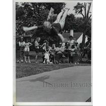 1974 Press Photo Girl takes a leap in the air during gymnastics routine