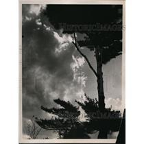 1936 Press Photo Washington DC Thunderclouds mask glory of spring sunset.