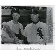 1951 Press Photo White Sox Manager Paul Richards Looks Over Bat With New Player