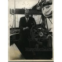 1928 Press Photo Mr. Dudley P Wolfe at wheel of his yacht Mohawk. - nee64575