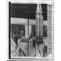 1958 Press Photo Scientist Robert Rykopf Adjusts Explorer Rocket's Antennas
