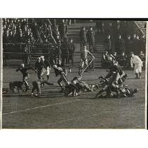 1930 Press Photo L. A. Bryan of Navy stops Bill Prentzel of Army in 1st qtr.