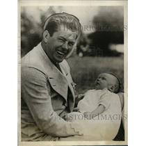 1928 Press Photo boxer Gene Tunney holding his godson, child of D. J. Mahoney