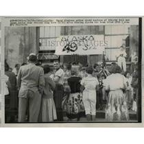 1958 Press Photo Juneau Alaska Happy Alaskans gather around Liberty Bell