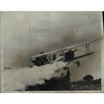 1934 Press Photo Cotton Duster Plane Roars Over Cotton Field in Hughes Arkansas