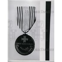 1937 Press Photo Medal given by British Red Cross to voluntary blood donors.