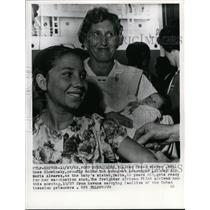 1962 Press Photo Mrs.Rose Slowinsky, carrying baby of Cuban Invasion prisoners.