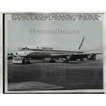 1960 Press Photo United Airlines DC-8 Jet towed from runway of O'hare Field