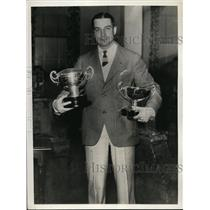 1934 Press Photo CE Baron winner of Bermuda golf tournament with his trophies