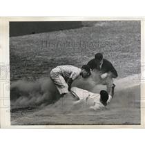1944 Press Photo Yankee Nick Etten slides into Senators Vaughn at 3rd base