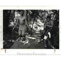 1986 Press Photo Norvester McMillan and brother William timing him - cva80215