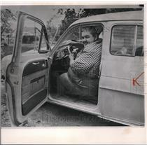 1964 Wire Photo Charles Robertson demonstrates that he can get behind wheel