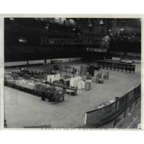 1976 Press Photo Two men examine Arena equipment to be sold at auction