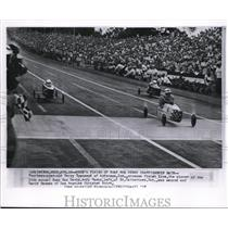 1957 Wire Photo 14 year old Terry Townsend crosses finish line, the winner of