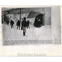 1962 Wire Photo The snow from the severe storm covers the Clear lake downtown