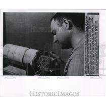 1958 Wire Photo Carl McIlwan makes the final adjustments on Explorer IV