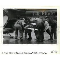1989 Press Photo Firefighters Carry Shawm McIlhagga to Life Flight Helicopter