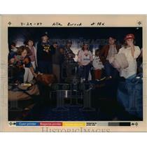 1987 Press Photo Travelers await their baggage at Portland International Airport