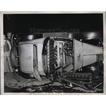 1934 Press Photo Four hurt when car overturned in Lynebrook LI - neb38325
