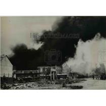 1936 Press Photo Belgian Strikers Responsible for Fire at Oil Refinery