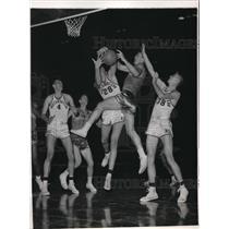 1957 Press Photo Joe Ruklick of Northwestern University takes rebound