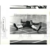1987 Press Photo LaRue Martin collapses until Lance Staab helps him up