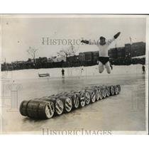 1931 Press Photo Carl Milno ice skate barrel jumper at NY carnival