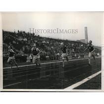 1938 Press Photo Adrian Talley wins 100 yard dash at IC4A in NYC, W Greer