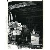 1987 Press Photo Jim Fry and his barn full of clothes, food and tools