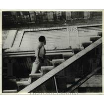 1968 Press Photo Lone swimmer ventures up the steps of Island of the Rose