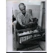 1960 Press Photo Loddie Woolsey builds wooden cradle  - nee92766
