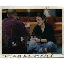 1999 Press Photo Waiting and playing at Portland International Airport