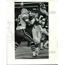 1985 Press Photo Berea QB Don Cirigliano is sacked by Todd Cramer. - cvb58752