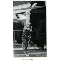 1988 Press Photo Anna Clark gives her glider a toss while playing at her home