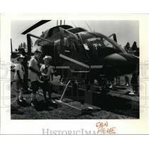 1987 Press Photo Kids inspecting a helicopter - spa22623