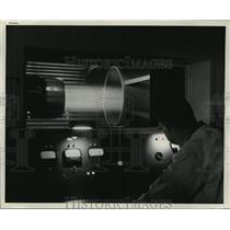 1954 Press Photo A bright bar of flame cuts through the darkened chamber